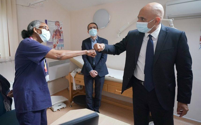 Health Secretary Sajid Javid fist-bumps a medic at a surgery in Forest Hill, south east London, today - PA