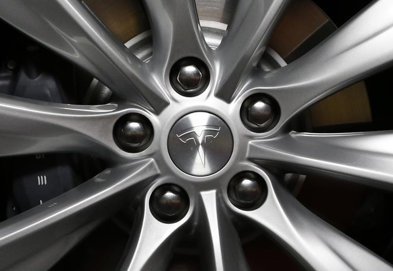 The logo is seen on a new all-wheel-drive version of the Tesla Model S car in Hawthorne