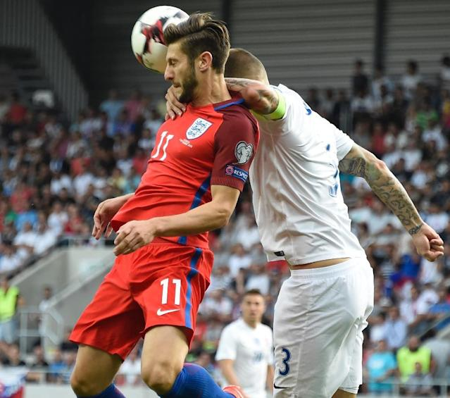 Adam Lallana (L) snatched a 95th-minute winner against 10-man Slovakia (AFP Photo/Joe Klamar)