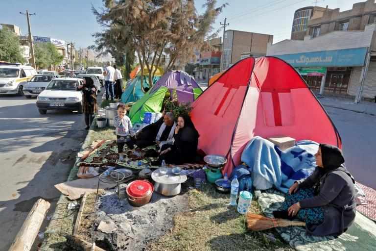 Displaced Iranians sit by their makeshift homes in the town of Sar-e Pol-e Zahab in Iran's western province of Kermanshah after a major earthquake