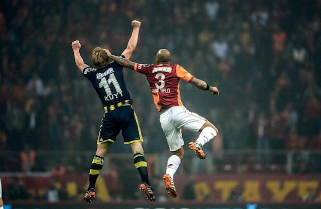 Rivalry between the Turkish football teams Fenerbahce (blue) and Galatasaray (red) dates back almost a century, with sides partly being decided by their geography in reference to the Bosphorus strait (AFP Photo/BULENT KILIC)