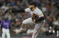 San Francisco Giants relief pitcher Kervin Castro works against the Colorado Rockies in the fifth inning of a baseball game Friday, Sept. 24, 2021, in Denver. (AP Photo/David Zalubowski)