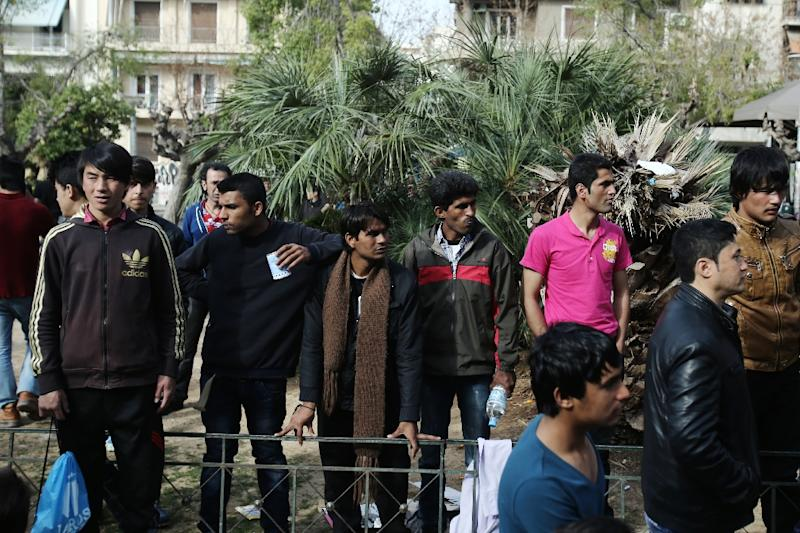 Migrants from Afghanistan stand in Victoria Square, central Athens (AFP Photo/Panayotis Tzamaros)