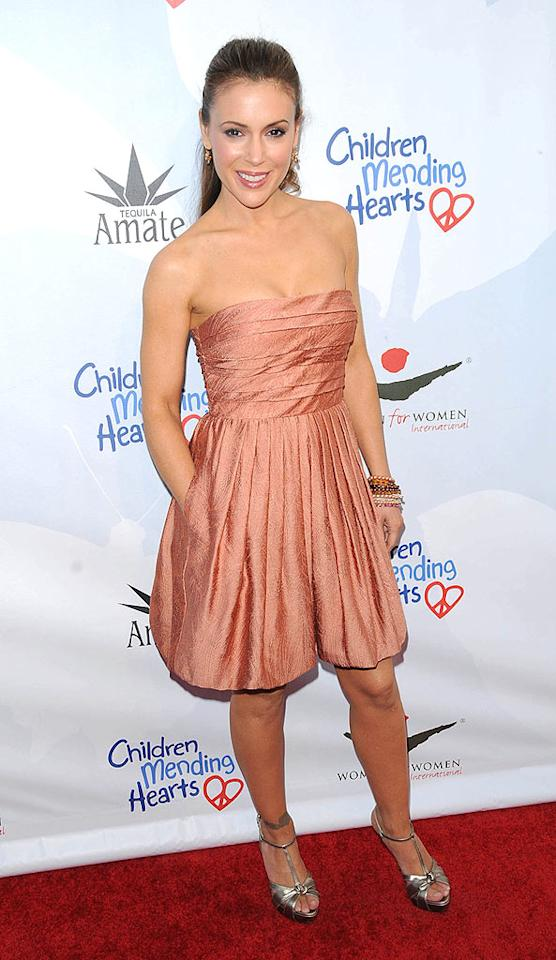 """Her new show, """"Romantically Challenged,"""" is a challenge to sit through, but we couldn't take our eyes off Alyssa Milano when the fresh-faced TV star arrived at the Peace Please charity benefit in a super-cute, coral cocktail frock and high ponytail. <a href=""""http://www.splashnewsonline.com"""" target=""""new"""">Splash News</a> - April 17, 2010"""