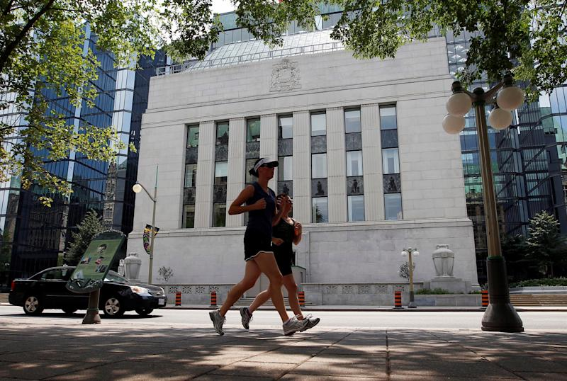 Joggers run past the Bank of Canada building in Ottawa July 17, 2012. (Reuters)