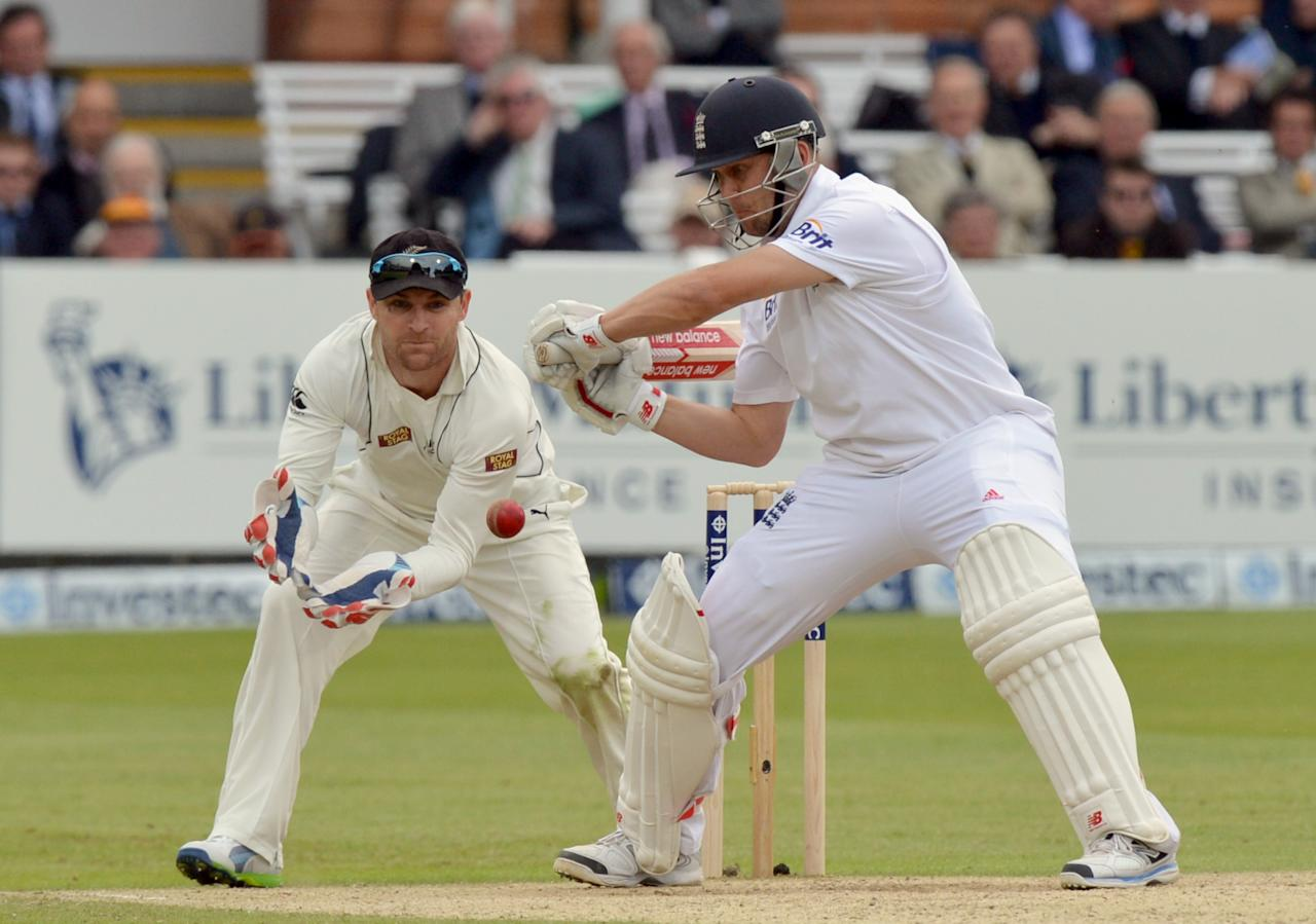 England's Jonathan Trott bats as New Zealand's Brendon McCullum acts as wicketkeeper following Bradley-John Watling's injury which saw him leave the field during the first test at Lord's Cricket Ground, London.