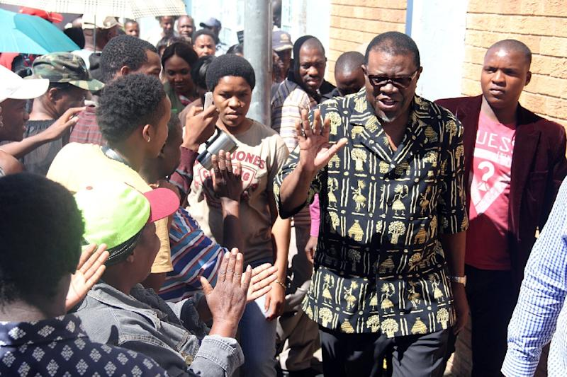 File photo shows then vice president of Namibia's ruling South West Africa People Organization (SWAPO) Hage Geingob (2R) after voting in Windhoek on November 28, 2014