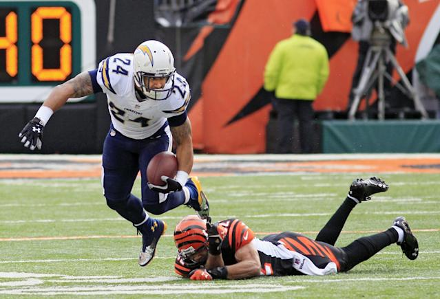San Diego Chargers running back Ryan Mathews (24) avoids the tackle by Cincinnati Bengals safety Chris Crocker in the first half of an NFL wild-card playoff football game on Sunday, Jan. 5, 2014, in Cincinnati. (AP Photo/Tom Uhlman)
