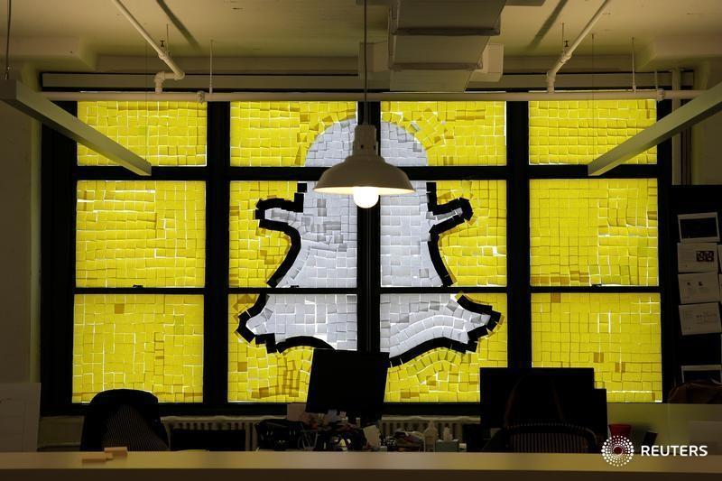 """Snapchat logo image created with Post-it notes is seen in the windows of Havas Worldwide offices at 200 Hudson street in lower Manhattan, New York during """"Post-it note war"""""""