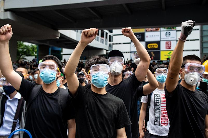 Hong Kong protesters ghave donned masks and goggles, both to protect themselves against tear gas and shield their identity