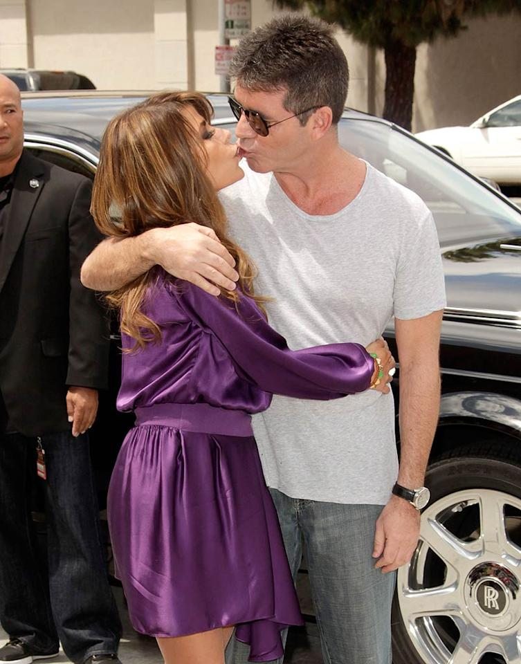 "Awwww. Who said Paula Abdul and Simon Cowell don't get along? After lots of speculation, Paula was indeed tapped to join her former ""American Idol"" castmate Simon as a judge and mentor on Fox's new singing reality competition show ""The X Factor."" The two were snapped getting smoochy during auditions in Los Angeles. (05/08/2011)"