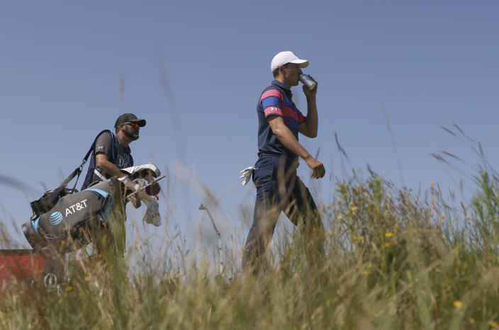 United States' Jordan Spieth takes a drink as he walks along the 3rd fairway during the final round of the British Open Golf Championship at Royal St George's golf course Sandwich, England, Sunday, July 18, 2021. (AP Photo/Peter Morrison)