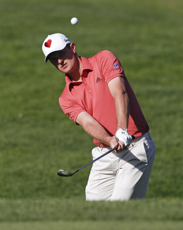 Justin Rose, of England, pitches to the first green during the third round of the Northern Trust Open golf tournament at Riviera Country Club in Los Angeles, Saturday, Feb. 18, 2012. (AP Photo/Chris Carlson)