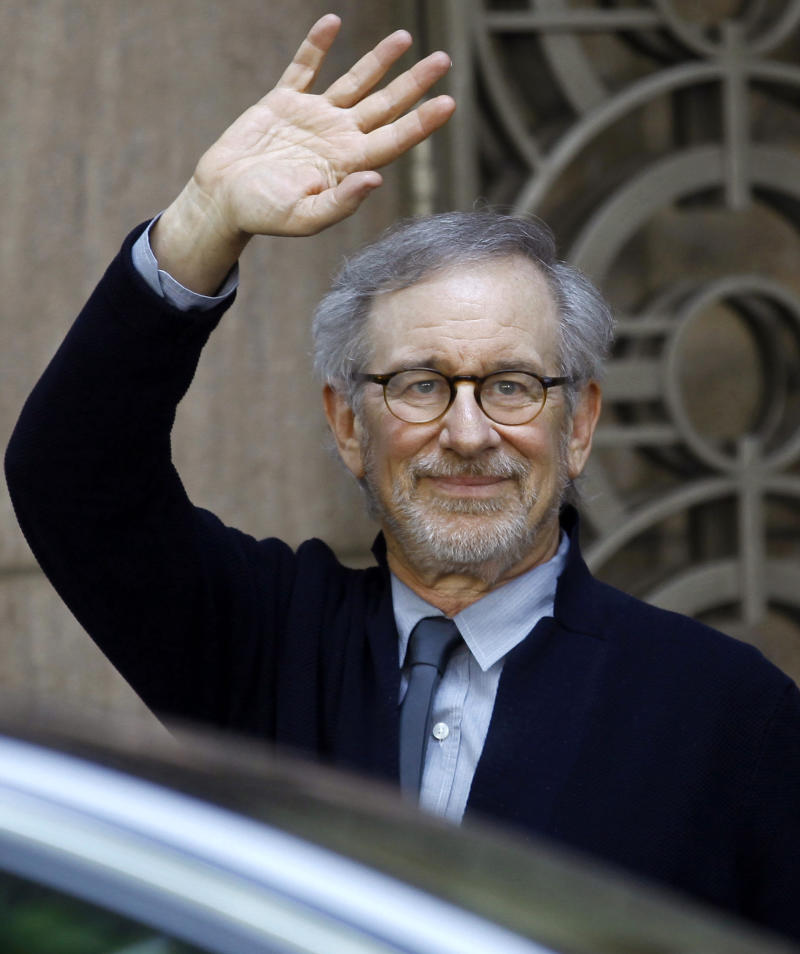 "FILE - In this March 11, 2013 file photo, Director Steven Spielberg waves to the media as he leaves Indian Industrialist Anil Ambani's office in Mumbai, India. The multiple Oscar-winning American director told Indian actor Amitabh Bachchan in a television interview aired Tuesda, March 13, 2013, that he chooses to work only on films that call out to him. Spielberg is in the western city of Mumbai — the home of Bollywood — to celebrate the success of his movie ""Lincoln,"" which was co-produced by the Indian company Reliance Entertainment. (AP Photo/Rafiq Maqbool, File)"