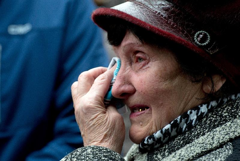 Valentina Dzuba, 72, mother of a miner, cries outside the Zasyadko mine in Donetsk after the mine was rocked by an explosion on March 4, 2015 (AFP Photo/John MacDougall)