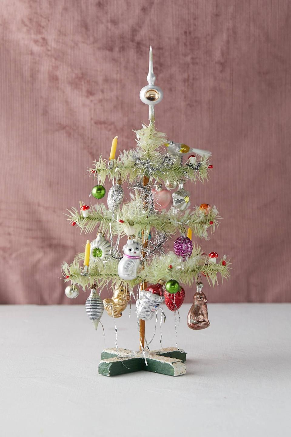 """<p>Complete with ornaments to match, you can't go wrong with this adorable <a href=""""https://www.popsugar.com/buy/Decorated-Feather-Mini-Christmas-Tree-502214?p_name=Decorated%20Feather%20Mini%20Christmas%20Tree&retailer=anthropologie.com&pid=502214&price=188&evar1=casa%3Aus&evar9=46615300&evar98=https%3A%2F%2Fwww.popsugar.com%2Fhome%2Fphoto-gallery%2F46615300%2Fimage%2F46767572%2FDecorated-Feather-Mini-Christmas-Tree&list1=shopping%2Canthropologie%2Choliday%2Cchristmas%2Cchristmas%20decorations%2Choliday%20decor%2Chome%20shopping&prop13=mobile&pdata=1"""" rel=""""nofollow noopener"""" class=""""link rapid-noclick-resp"""" target=""""_blank"""" data-ylk=""""slk:Decorated Feather Mini Christmas Tree"""">Decorated Feather Mini Christmas Tree</a> ($188).</p>"""