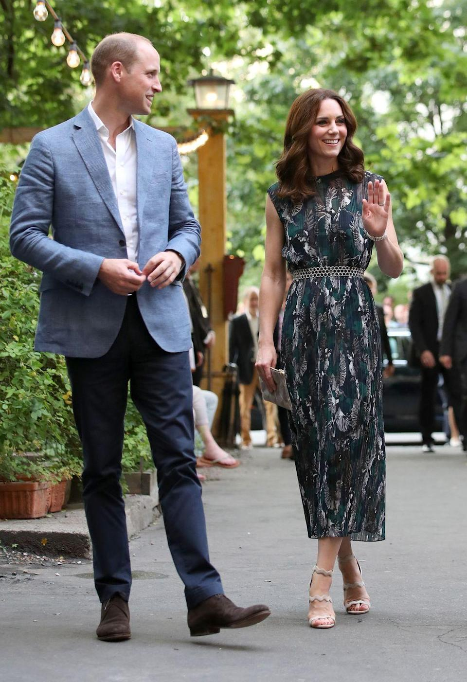 """<p>Okay, before you get all """"wait, Meghan and Kate's dresses look <em>nothing </em>alike<em>,</em>"""" please note the length of Kate's dress and its cut and belt detail. This is a Markus Lupfer dress, by the way, which the Duchess wore in Berlin in 2017. </p>"""
