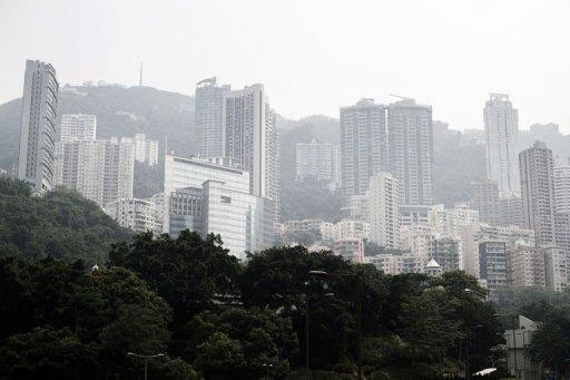 High rise residential buildings are seen shrouded in a dense blanket of toxic smog in Hong Kong. Hong Kong choked under the worst smog ever recorded in the city, with residents warned to stay indoors, away from the blanket of toxic haze