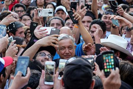 Mexican politician Andres Manuel Lopez Obrador, (C), leader of the National Regeneration Movement (MORENA) party arrives for a meeting at Plaza Olivera in Los Angeles, California, U.S., February 12, 2017. REUTERS/Ringo Chiu