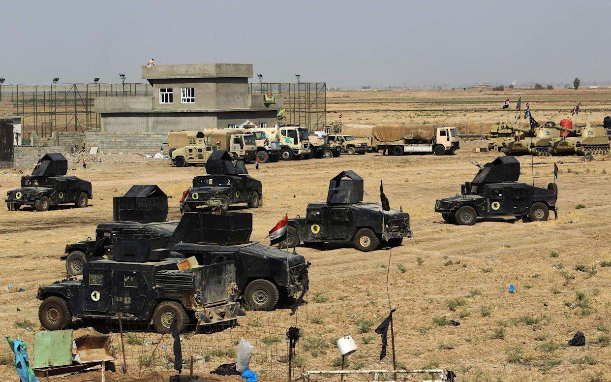 Iraqi forces gather in the area of Taza Khurmata on the southern outskirts of Kirkuk on October 15 - AFP