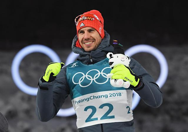 <p>Arnd Peiffer of Germany celebrates winning the gold medal during the victory ceremony after the Men's 10km Sprint Biathlon. </p>