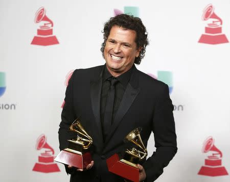 "Carlos Vives poses with his awards for Record of the Year and Song of the Year for ""La Bicicleta"" during the 17th Annual Latin Grammy Awards in Las Vegas, Nevada, U.S., November 17, 2016.  REUTERS/Steve Marcus"