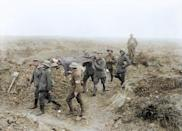 <p>Injured Captain Benjamin H Geary VC is carried off on a stretcher by prisoner bearers at Achiet-le Petit on 21st August 1918 (Royston Leonard / Media Drum World / Caters News) </p>