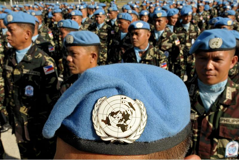 File photo taken on April 12, 2010 shows UN peacekeepers from the Philippines recently returned from Haiti and Liberia at military headquarters in Manila (AFP Photo/Jay Directo)