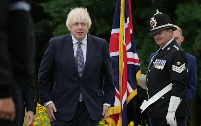 Boris Johnson attends the dedication ceremony of the National Police Memorial - Getty