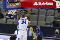 Creighton guard Denzel Mahoney (34) makes a 3-point shot against Connecticut in the second half during an NCAA college basketball game Saturday, Jan. 23, 2021, in Omaha, Neb. (AP Photo/John Peterson)