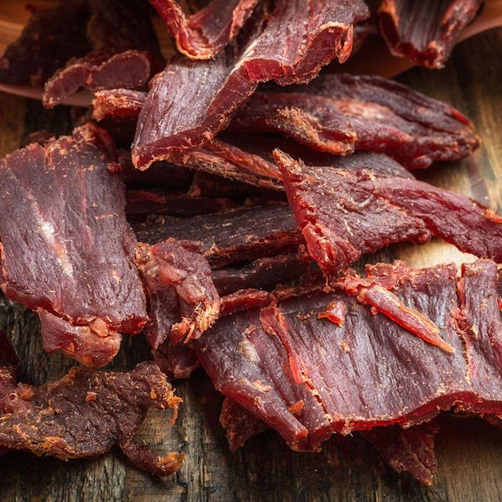 """<p>Sure, this delish snack conveniently gives you access to protein on the run, but most jerkies are chock-full of sodium to preserve the meat. """"The increased sodium intake can cause water retention and bloating,"""" says Rebecca Lewis, R.D., in-house dietitian at <a href=""""https://go.redirectingat.com?id=74968X1596630&url=https%3A%2F%2Fwww.hellofresh.com%2Ftasty%2F&sref=https%3A%2F%2Fwww.womenshealthmag.com%2Ffood%2Fg22617152%2Ffake-health-foods-to-avoid%2F"""" rel=""""nofollow noopener"""" target=""""_blank"""" data-ylk=""""slk:HelloFresh"""" class=""""link rapid-noclick-resp"""">HelloFresh</a>. Lewis recommends opting for low-sodium turkey jerky instead. """"It's just as delicious without all the salt,"""" she says.</p>"""