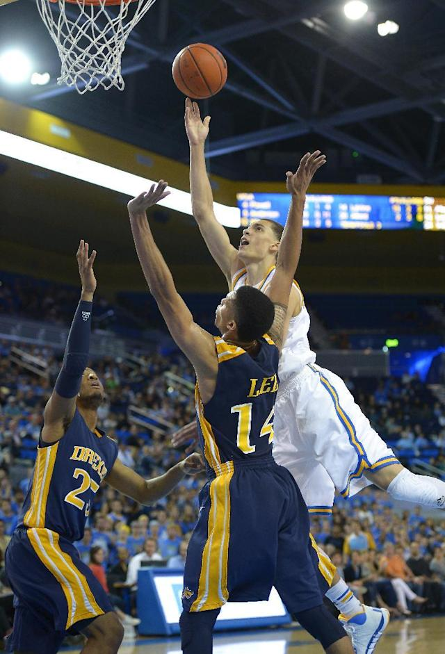 UCLA guard Zach LaVine, right, puts up a shot as Drexel guard Major Canady, left, and guard Damion Lee defend during the second half of an NCAA college basketball game, Friday, Nov. 8, 2013, in Los Angeles. UCLA won 72-67. (AP Photo/Mark J. Terrill)