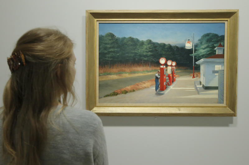 """A woman looks at """"Gas 1940"""" as part of the retrospective of Edward Hopper, one of the great American 20th century artists at Paris' Grand Palais Museum, in Paris, Monday, Oct. 8, 2012. This major Hopper retrospective reveals that the 20th century painter known for his rendering of American life, also drew inspiration from France. (AP Photo/Francois Mori)"""