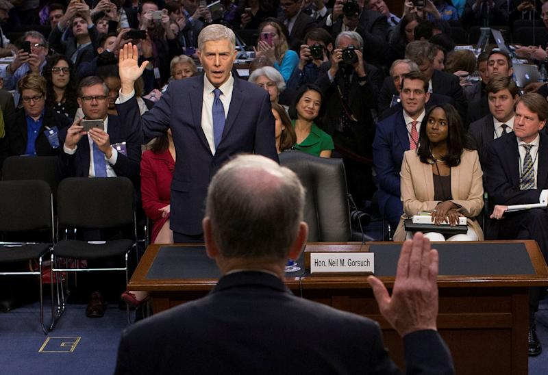 Mary Elizabeth Taylor, right, observes as Senate Judiciary Committee Chairman Chuck Grassley (R-Iowa) swears in Neil Gorsuch during the first day of his Supreme Court confirmation hearing on March 20, 2017.