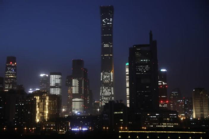 Buildings in the Central Business District (CBD) are seen lit up during the night in Beijing