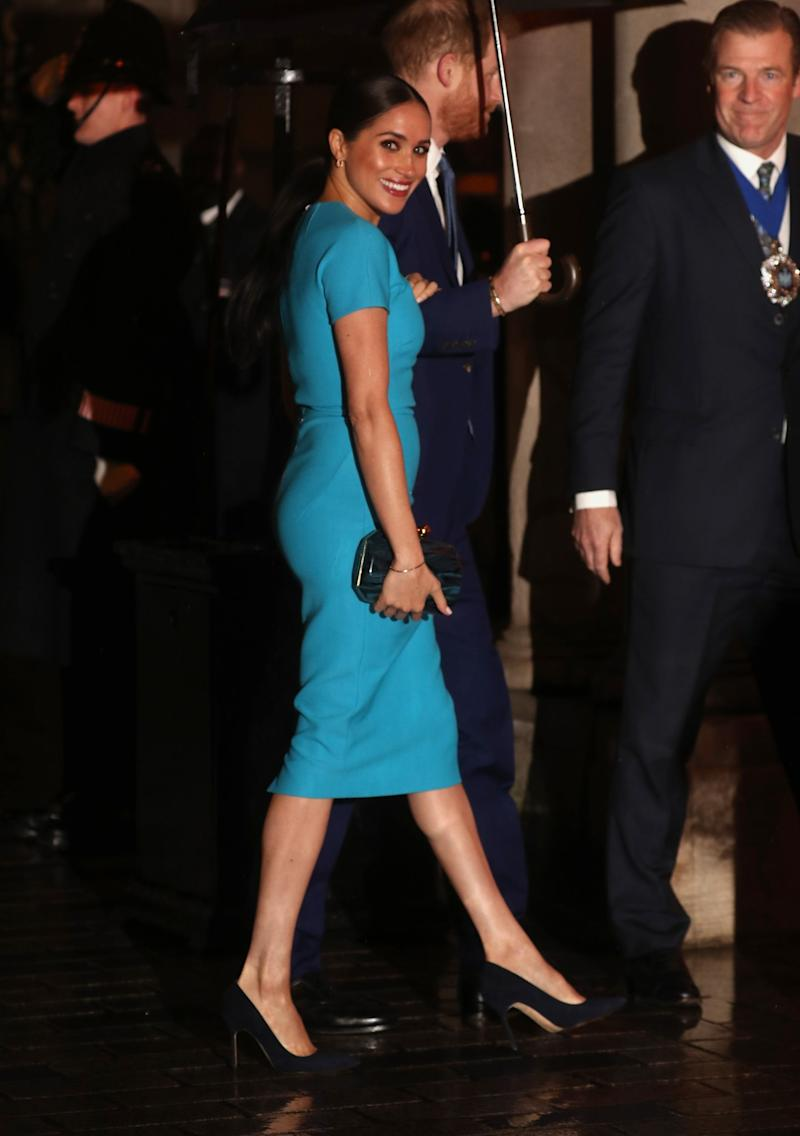 Markle wearing a blue dress by Victoria Beckham for the Royal Endeavour Awards in March (Getty Images)