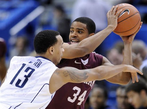 Fordham's Jermaine Myers, right, is guarded by Connecticut's Shabazz Napier during the first half of an NCAA college basketball game in Hartford, Conn., Friday, Dec. 21, 2012. (AP Photo/Fred Beckham)