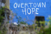 A mural by artist Kyle Holbrook reading Overtown Hope is painted on a building near railroad tracks on the western edge of downtown Miami, Sunday, May 16, 2021, in the Overtown neighborhood in Miami. (AP Photo/Lynne Sladky)