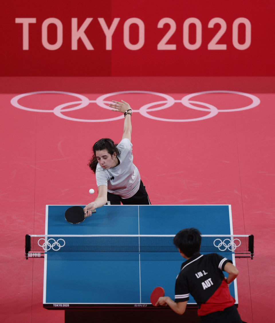 TOKYO, JAPAN - JULY 24: Hend Zaza (C) of Team Syria in action against Liu Jia (bottom) of Team Austria during their Women's Singles Preliminary Round table tennis match on day one of the Tokyo 2020 Olympic Games at Tokyo Metropolitan Gymnasium on July 24, 2021 in Tokyo, Japan. (Photo by Ezra Shaw/Getty Images)