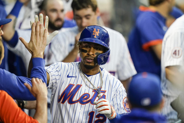 New York Mets' Francisco Lindor (12) celebrates with teammates after hitting a two-run home run during the sixth inning in the first baseball game of a doubleheader against the Miami Marlins Tuesday, Sept. 28, 2021, in New York. The Mets won 5-2. (AP Photo/Frank Franklin II)