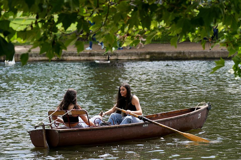 Friends row along the River Avon (PA Wire)