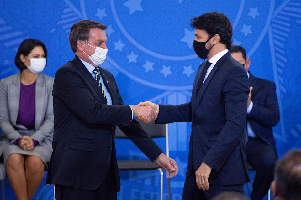 BRASILIA, BRAZIL - JUNE 17:President of Brazil Jair Bolsonaro and newly appointedMinister of Communications Fábio Faria shake hands duringhis sworn in ceremony amidstthe coronavirus (COVID-19) pandemic at the Planalto Palace on June 17 2020 in Brasilia.Brazil has over 923,000 confirmed positive cases of Coronavirus and 45,241 deaths. (Photo by Andressa Anholete/Getty Images)