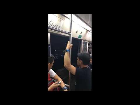 <p>Jason Ibe captured a terrifying moment when the door of a tram in the Phillippines didn't close after leaving the previous station. The commuters stared out as the tram sped through the city. Credit: Jason Ibe via Storyful</p>