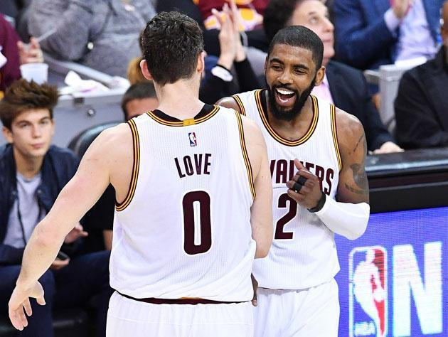 Kevin Love and Kyrie Irving share the stage. (Getty Images)
