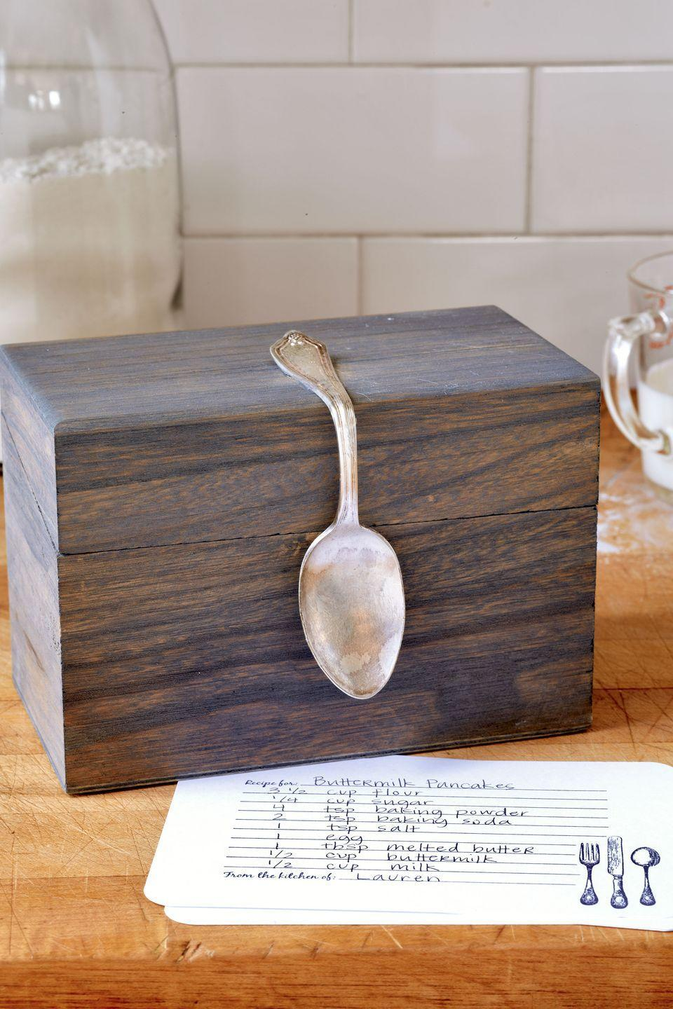 """<p>Turn a $6 box into a fabulous recipe organizer. A flea-market spoon is the secret ingredient to punching up an <a href=""""https://go.redirectingat.com?id=74968X1596630&url=http%3A%2F%2Fwww.michaels.com%2Fwooden-recipe-box-by-artminds%2F10397769.html&sref=https%3A%2F%2Fwww.countryliving.com%2Fdiy-crafts%2Ftips%2Fg645%2Fcrafty-christmas-presents-ideas%2F"""" rel=""""nofollow noopener"""" target=""""_blank"""" data-ylk=""""slk:unfinished box"""" class=""""link rapid-noclick-resp"""">unfinished box</a>. With a foam brush, stain the box, inside and out, with <a href=""""https://go.redirectingat.com?id=74968X1596630&url=https%3A%2F%2Fwww.lowes.com%2Fpd%2FMinwax-Classic-Grey-Interior-Stain-Actual-Net-Contents-32-fl-oz%2F999914517&sref=https%3A%2F%2Fwww.countryliving.com%2Fdiy-crafts%2Ftips%2Fg645%2Fcrafty-christmas-presents-ideas%2F"""" rel=""""nofollow noopener"""" target=""""_blank"""" data-ylk=""""slk:Minwax wood finish in Classic Gray"""" class=""""link rapid-noclick-resp"""">Minwax wood finish in Classic Gray</a><em>. </em>Let dry overnight.Using your hands, bend a teaspoon at a 90-degree angle. Lightly sand the widest point of the handle's back side.Apply <a href=""""https://www.amazon.com/Beacon-Glass-Premium-Permanent-2-Ounce/dp/B00083QL5M/?tag=syn-yahoo-20&ascsubtag=%5Bartid%7C10050.g.645%5Bsrc%7Cyahoo-us"""" rel=""""nofollow noopener"""" target=""""_blank"""" data-ylk=""""slk:Glass, Metal & More glue"""" class=""""link rapid-noclick-resp"""">Glass, Metal & More glue</a> along the sanded area<em>.</em> Center the spoon atop the box, press and hold for one minute, then let set overnight. For extra flourish, include a set of <a href=""""https://go.redirectingat.com?id=74968X1596630&url=https%3A%2F%2Fwww.etsy.com%2Flisting%2F263334005%2Frecipe-cards-set-of-15-30-or-50&sref=https%3A%2F%2Fwww.countryliving.com%2Fdiy-crafts%2Ftips%2Fg645%2Fcrafty-christmas-presents-ideas%2F"""" rel=""""nofollow noopener"""" target=""""_blank"""" data-ylk=""""slk:recipe cards"""" class=""""link rapid-noclick-resp"""">recipe cards</a>. </p><p><strong><a class=""""link rapid-noclick-resp"""" href=""""https://go."""
