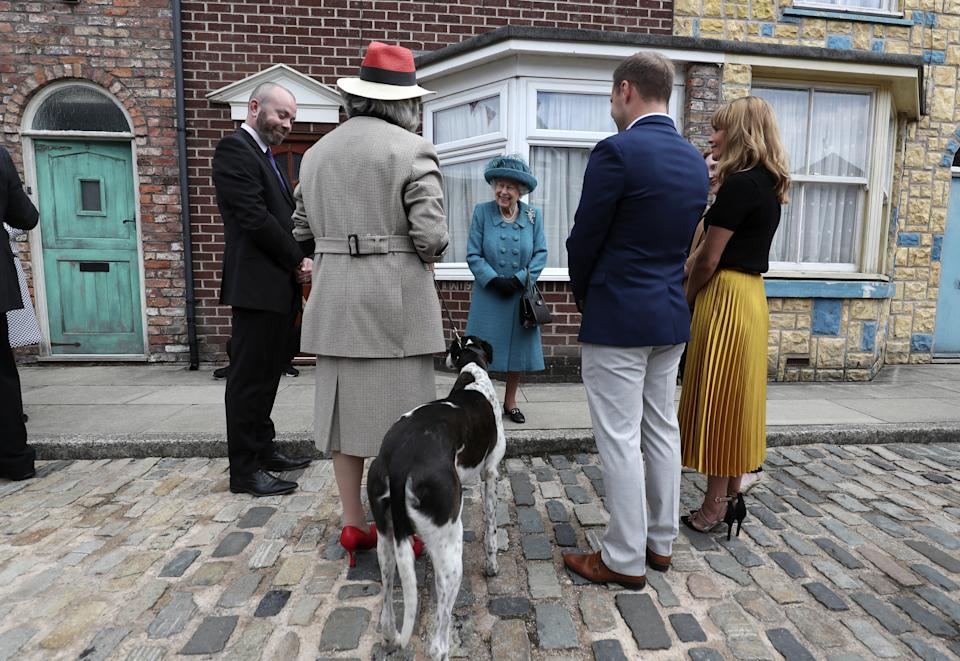 Queen Elizabeth II meets actors and members of the production team during a visit to the set of Coronation Street at the ITV Studios, Media City UK, Manchester. Picture date: Thursday July 8, 2021.