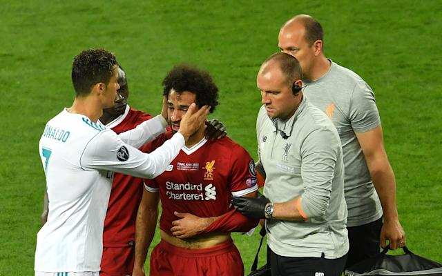 Cristiano Ronaldo comfort Mohamed Salah as he leaves the pitch in tears - 2018 Getty Images