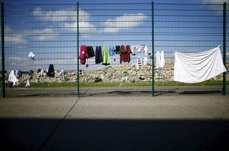 Laundry hung out to dry on a fence surrounding former U.S. army housing barracks used as a refugee registration center for the German state of Hesse in Giessen