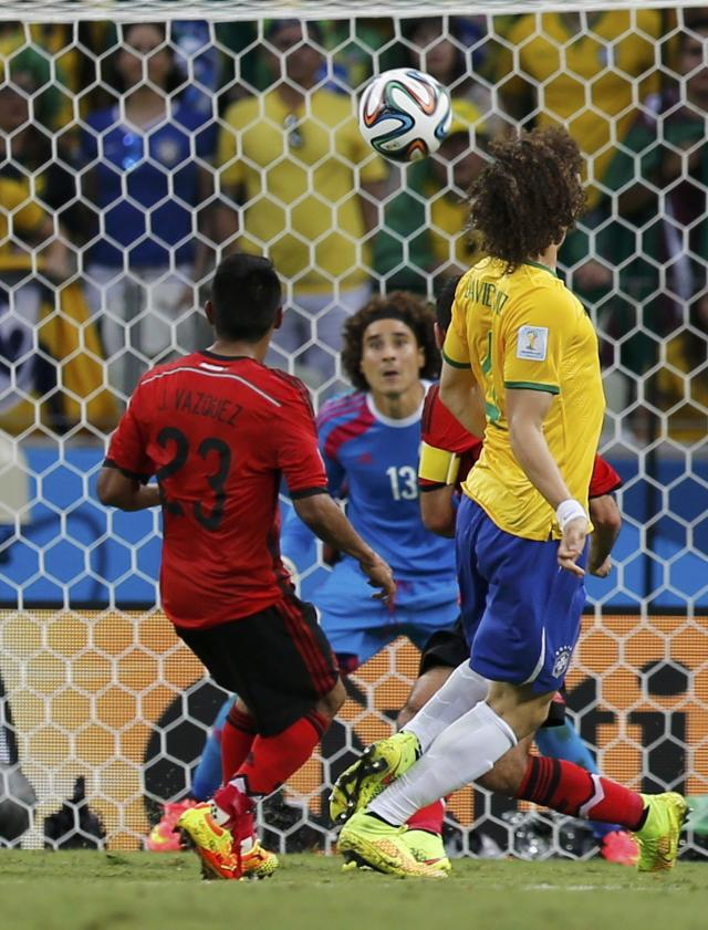 Mexico's goalkeeper Guillermo Ochoa prepares to make a save during the 2014 World Cup Group A soccer match between Brazil and Mexico at the Castelao arena