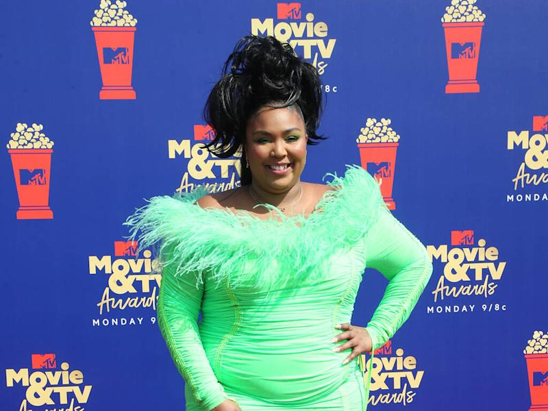 Lizzo felt left out as a child because 'no one on TV looked like me'